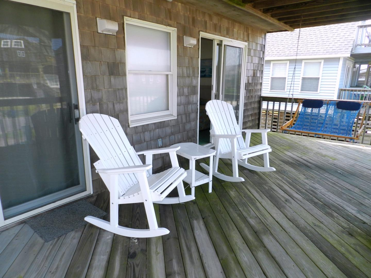 Deck w/ Swing and Adirondack chairs