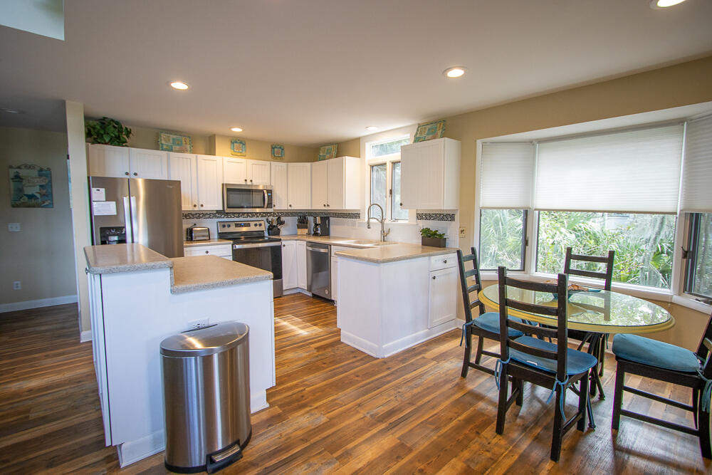 Kitchen with all new stainless steel appliances, drip coffee maker, 4 seat table