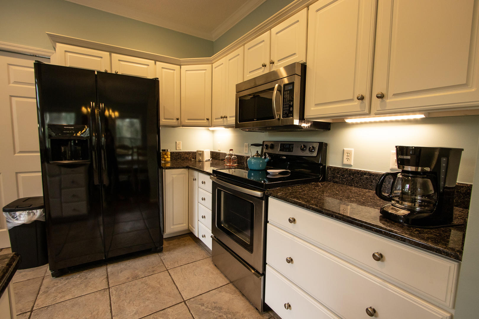 Kitchen, 2 seats at bar, coffee pot, laundry room attached
