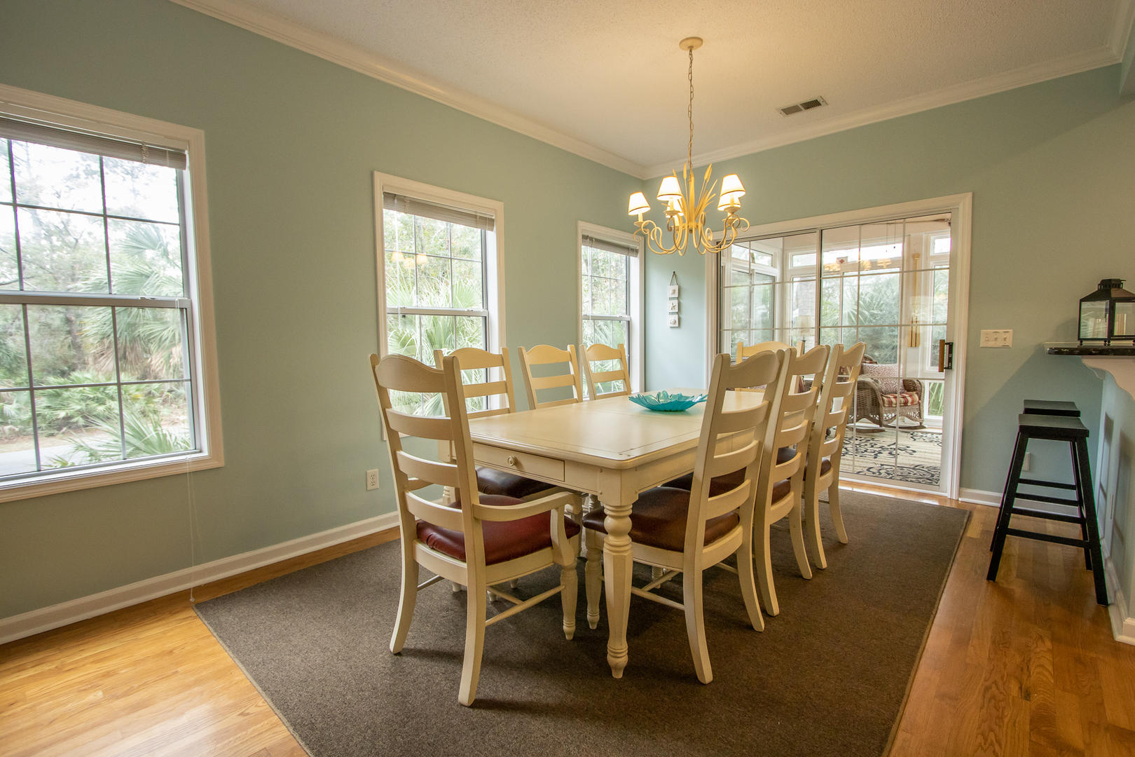 Dining, next to kitchen, 8 seat table, access to screened porch