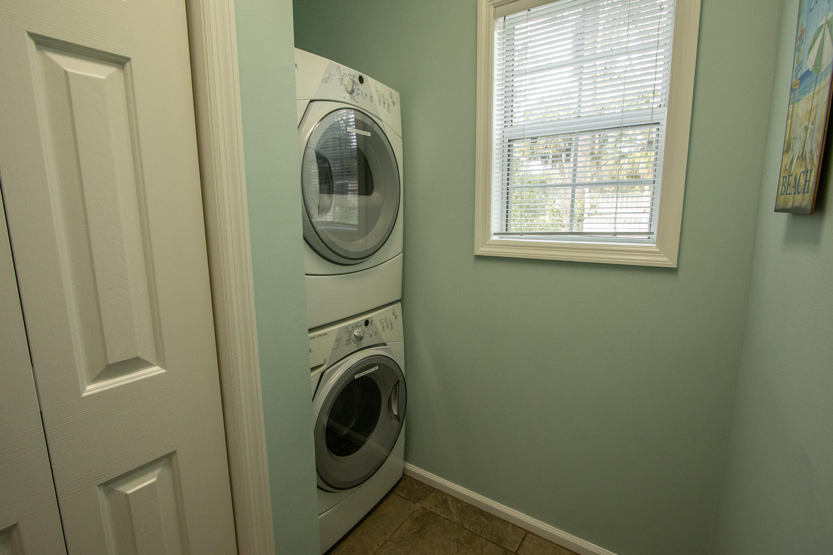 Laundry room attached to kitchen