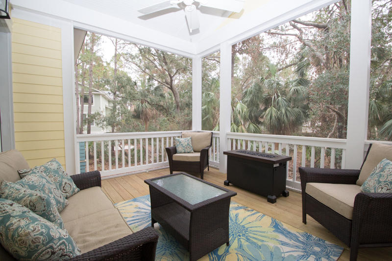 Screened porch with fire table off living room