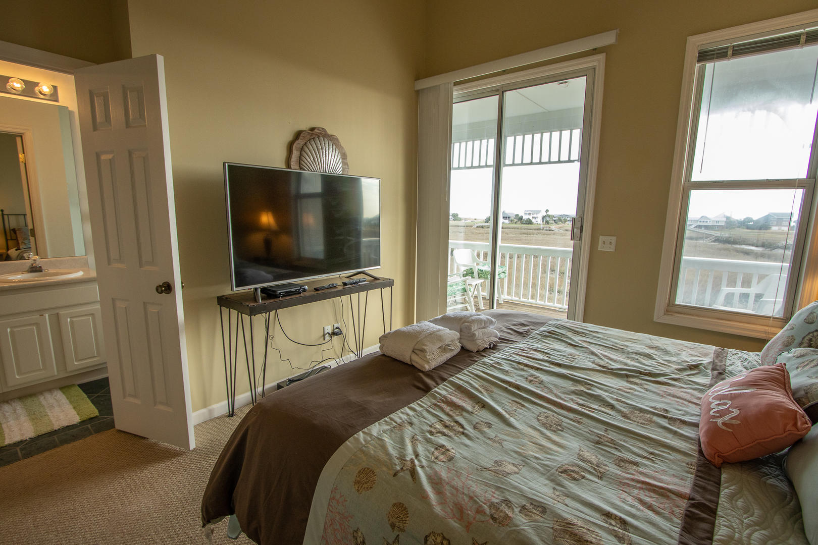 Master, 2nd floor, TV w/ DVD player, access to balcony, en suite full bath