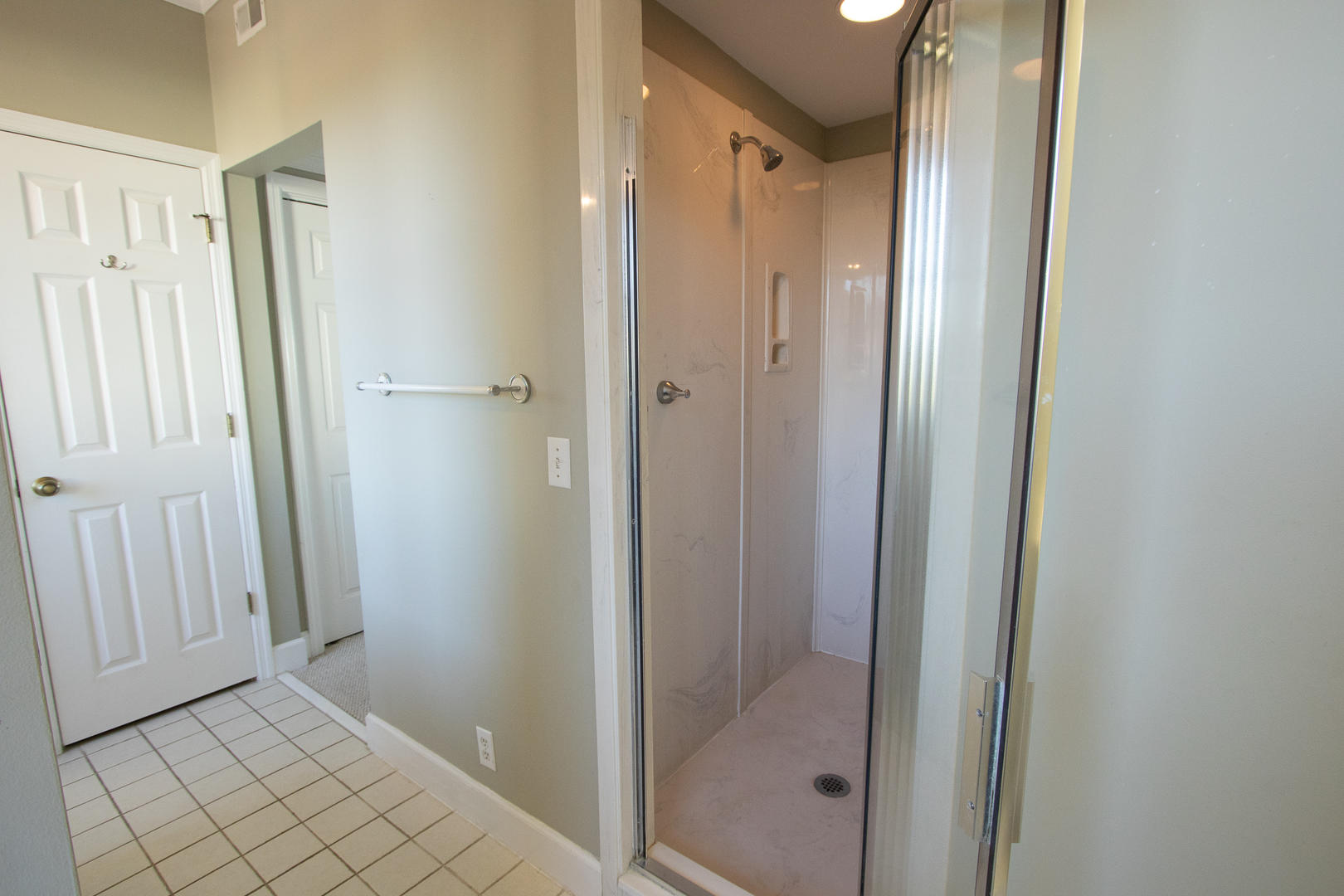 Attached to 1st floor master, sit down vanity, 2 showers