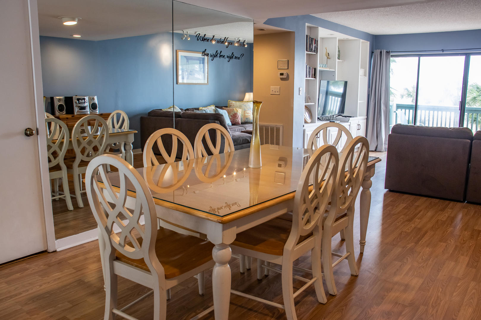 6 seat dining table, between kitchen and living