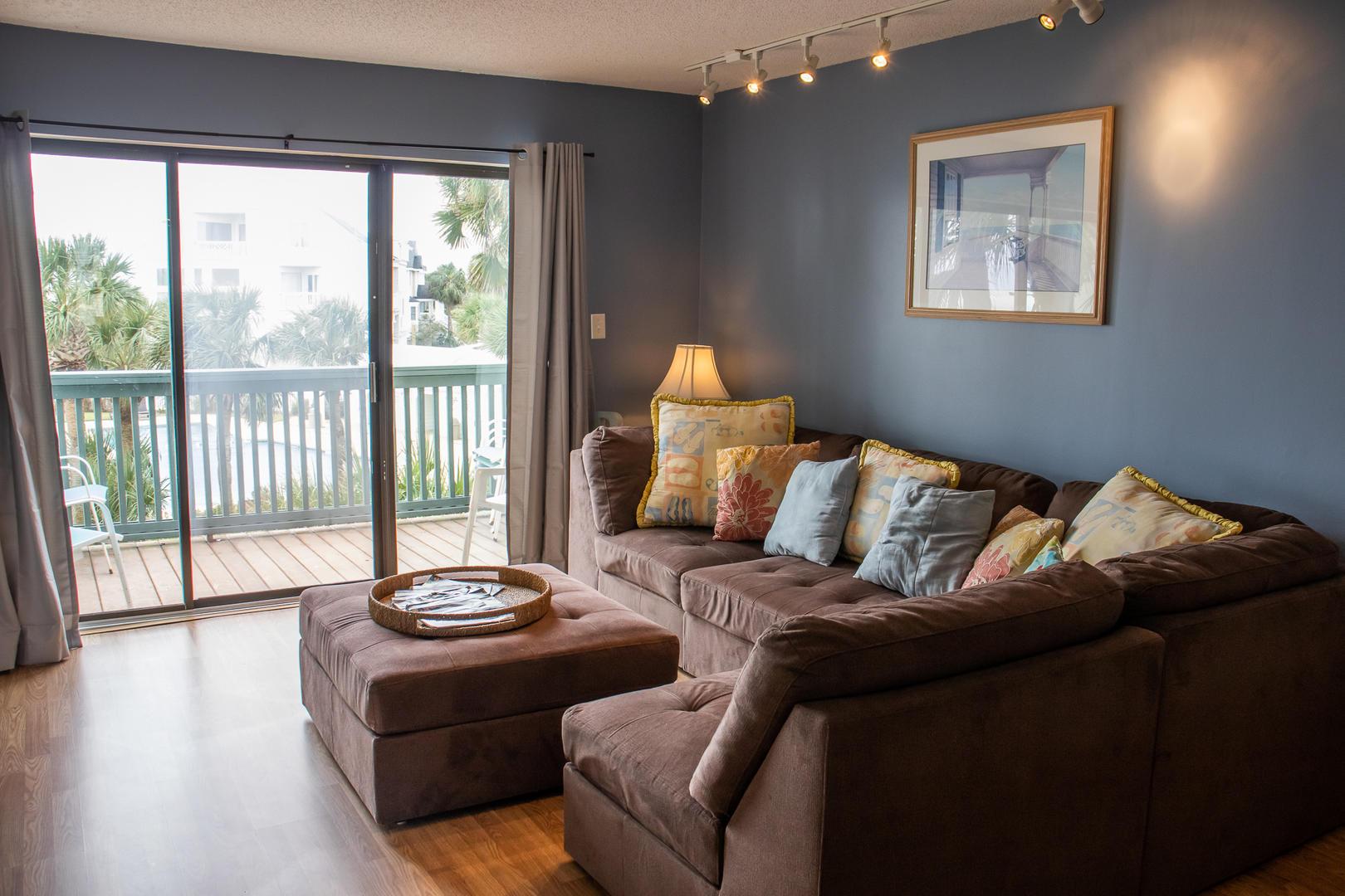 Living, TV w/ DVD player, balcony access