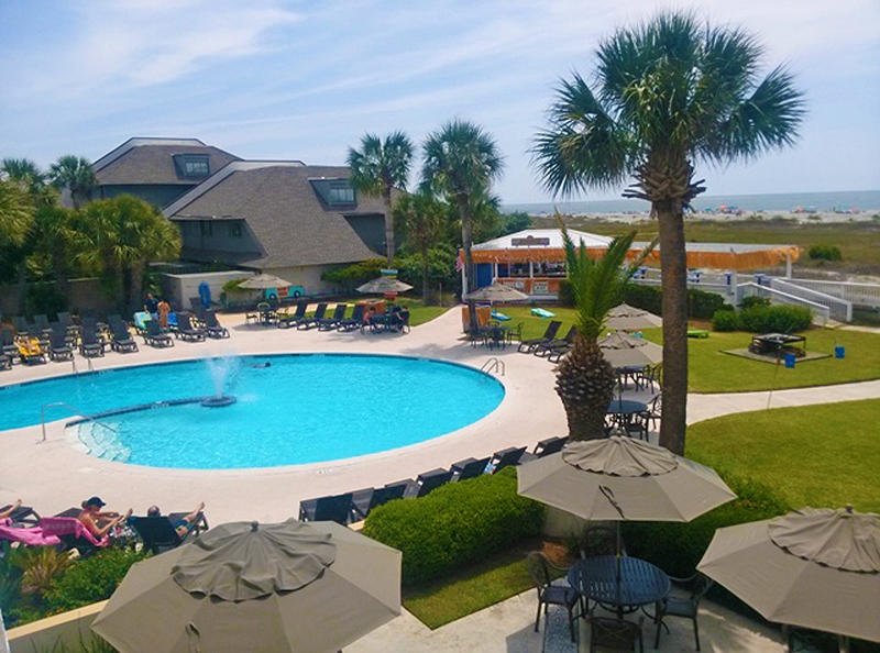 The Beach Club, Adult Pool, Sandbar and Ocean View Bar are centrally located on the island.