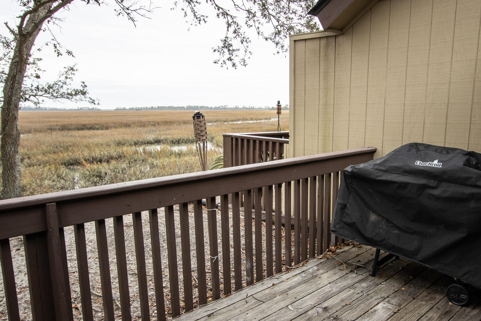 Balcony, seating, grill, and marsh views