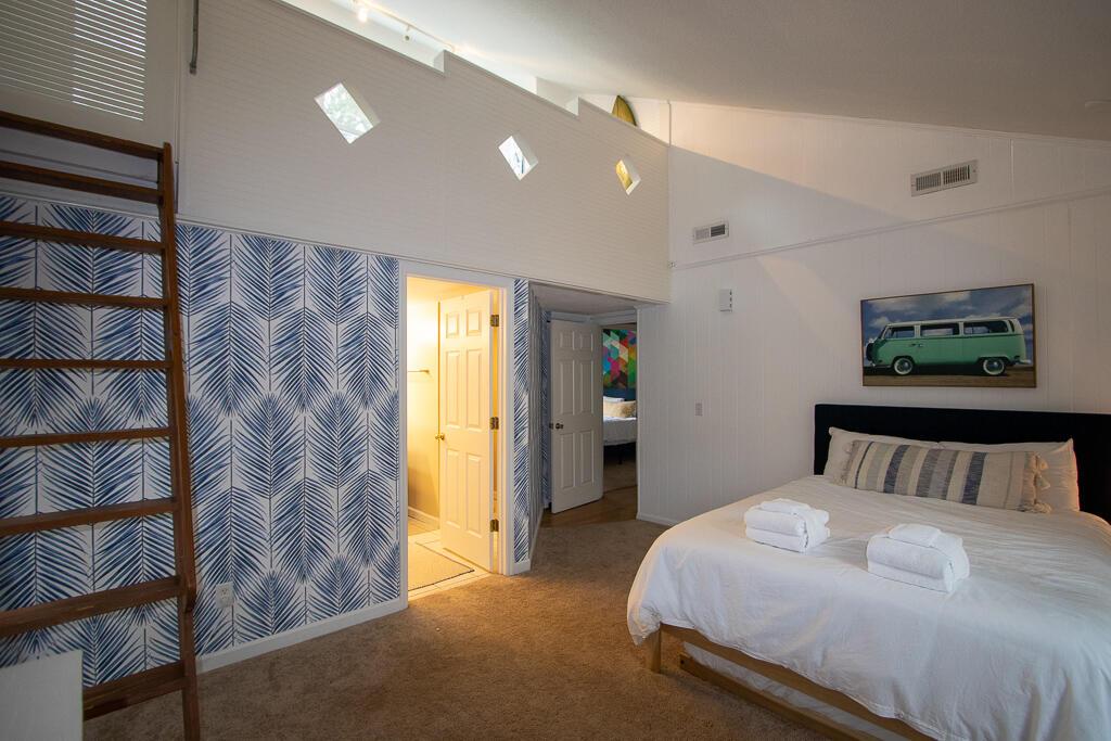 Bedroom 1, TV, loft, en suite full bath, access to outside