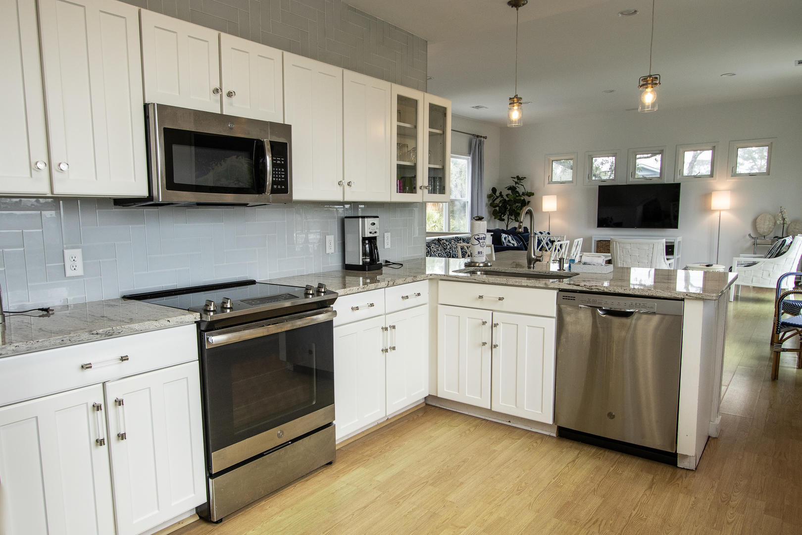 Kitchen, 2nd floor, coffee pot, 2 seats at bar, access to screened balcony
