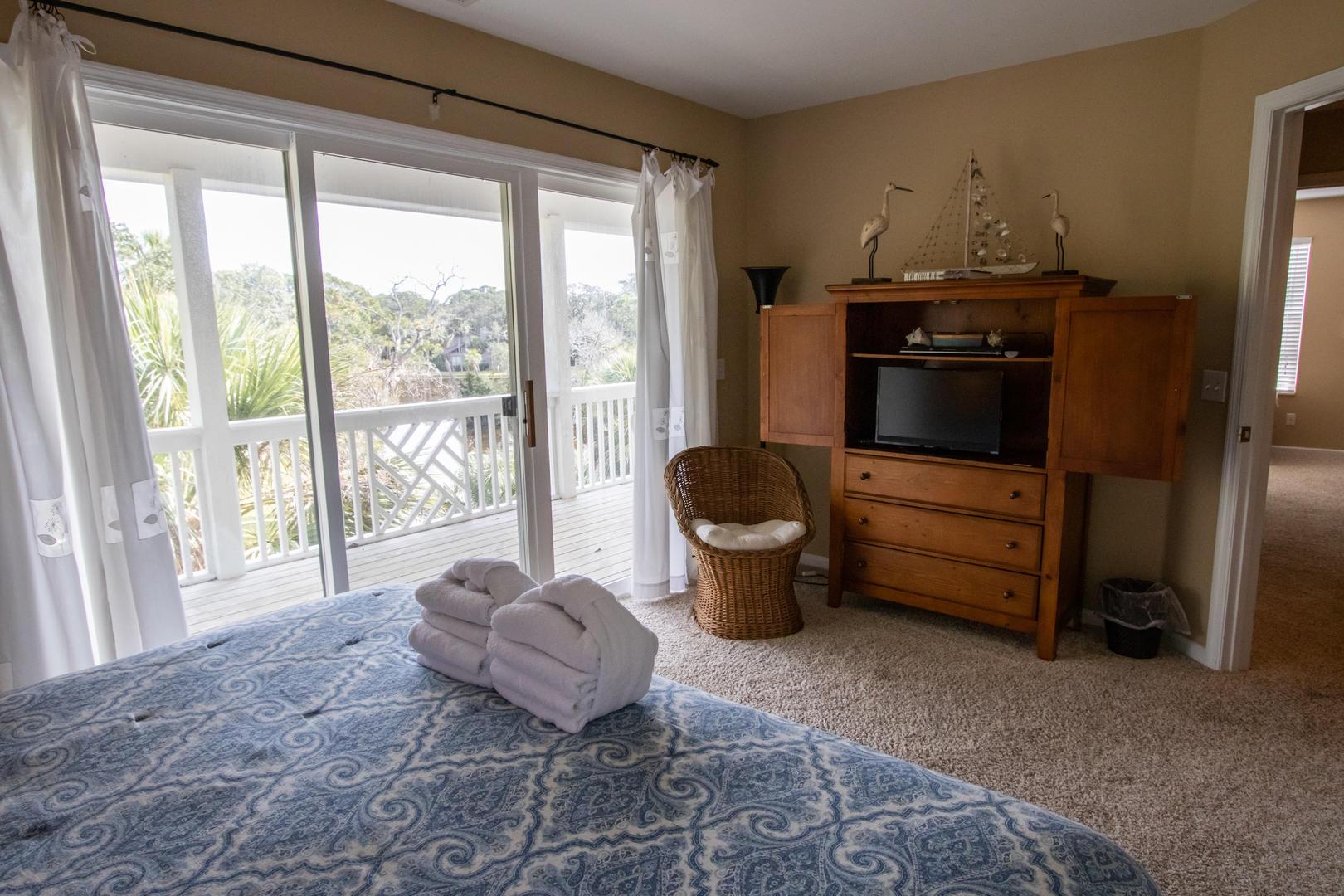 Bedroom 2, 2nd floor, TV w/ DVD player, access to balcony