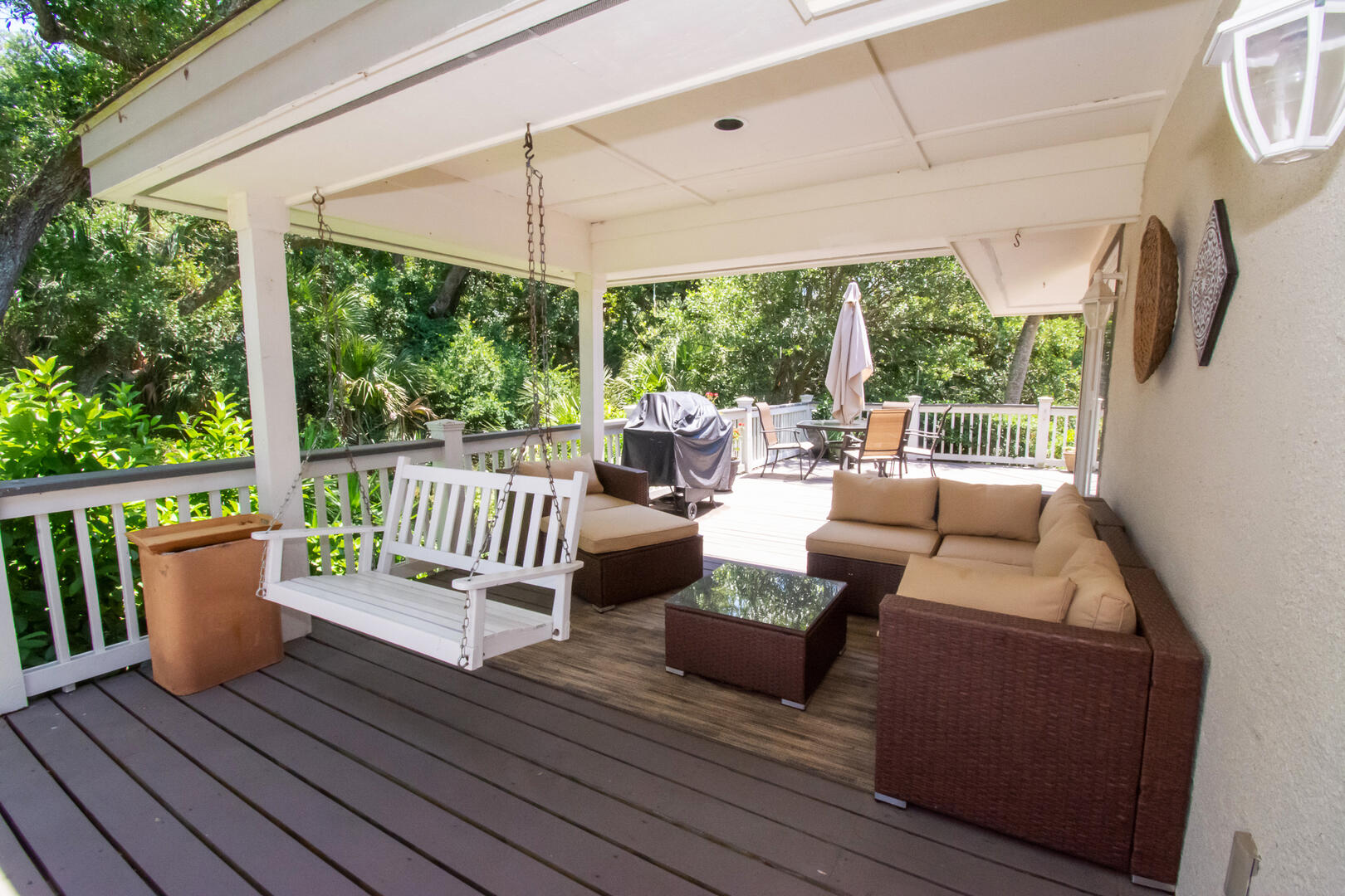 Porch with swing and sitting area and gas grill