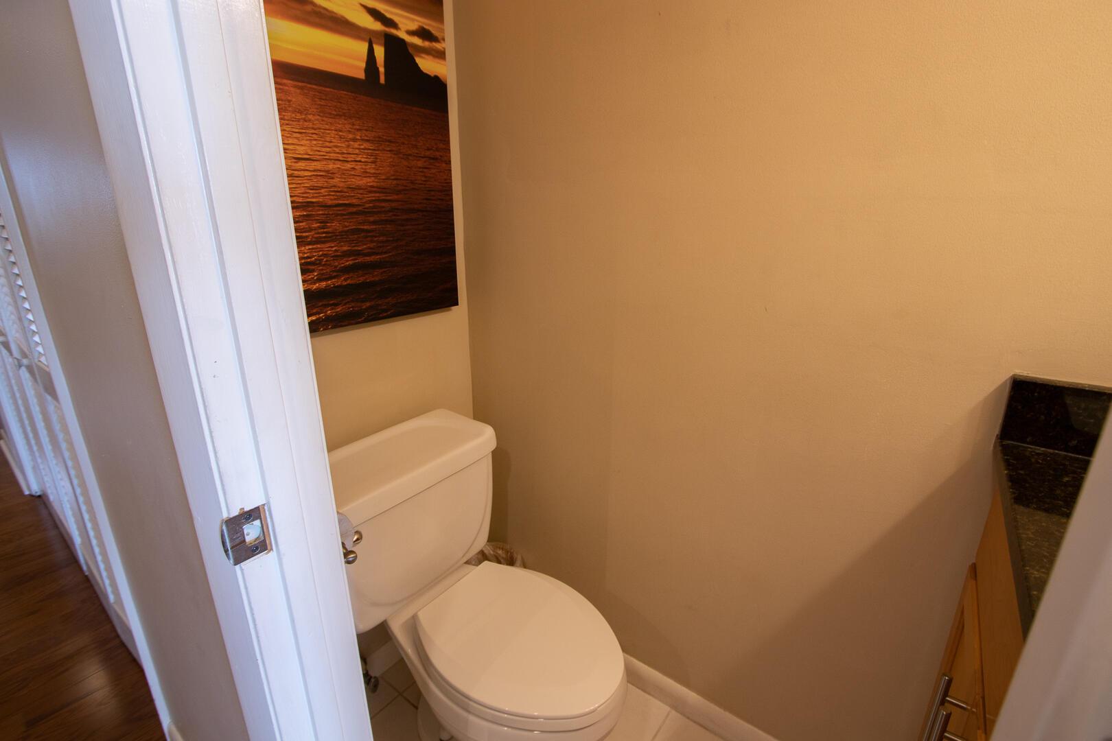 1/2 bath in hallway near kitchen