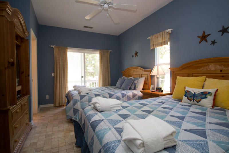 Double queen bedroom on first floor with en suite bath and front deck