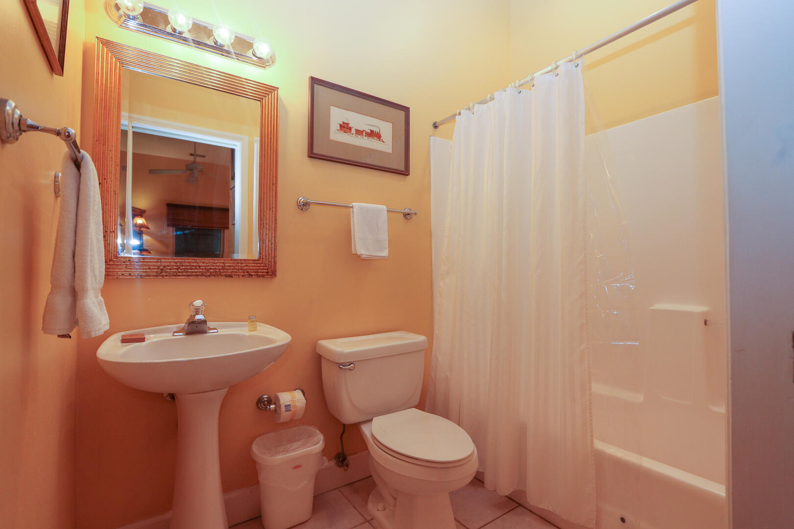 En suite bath for bedroom off entry hallway