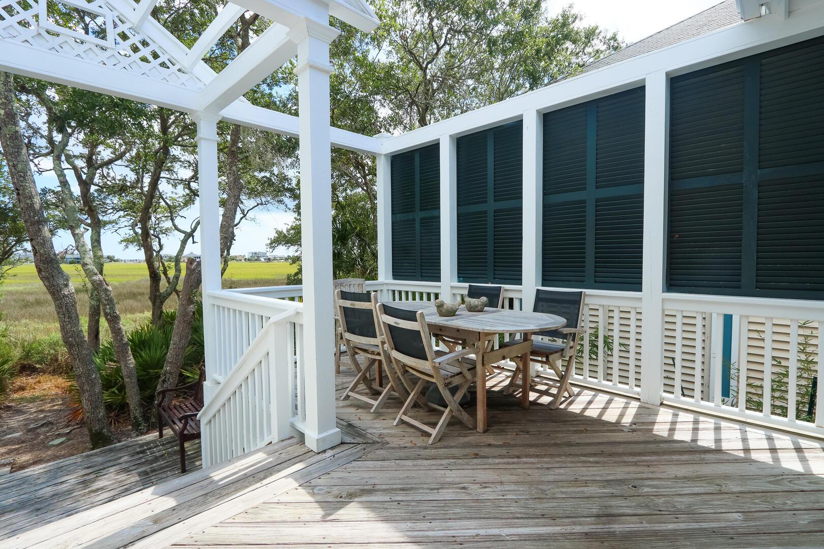 Back deck outdoor dining overlooking marsh