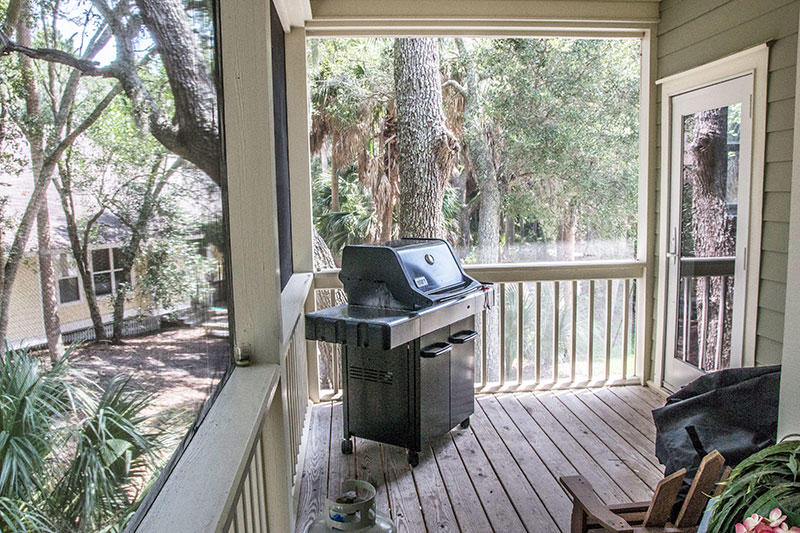 Back screened in porch with gas grill