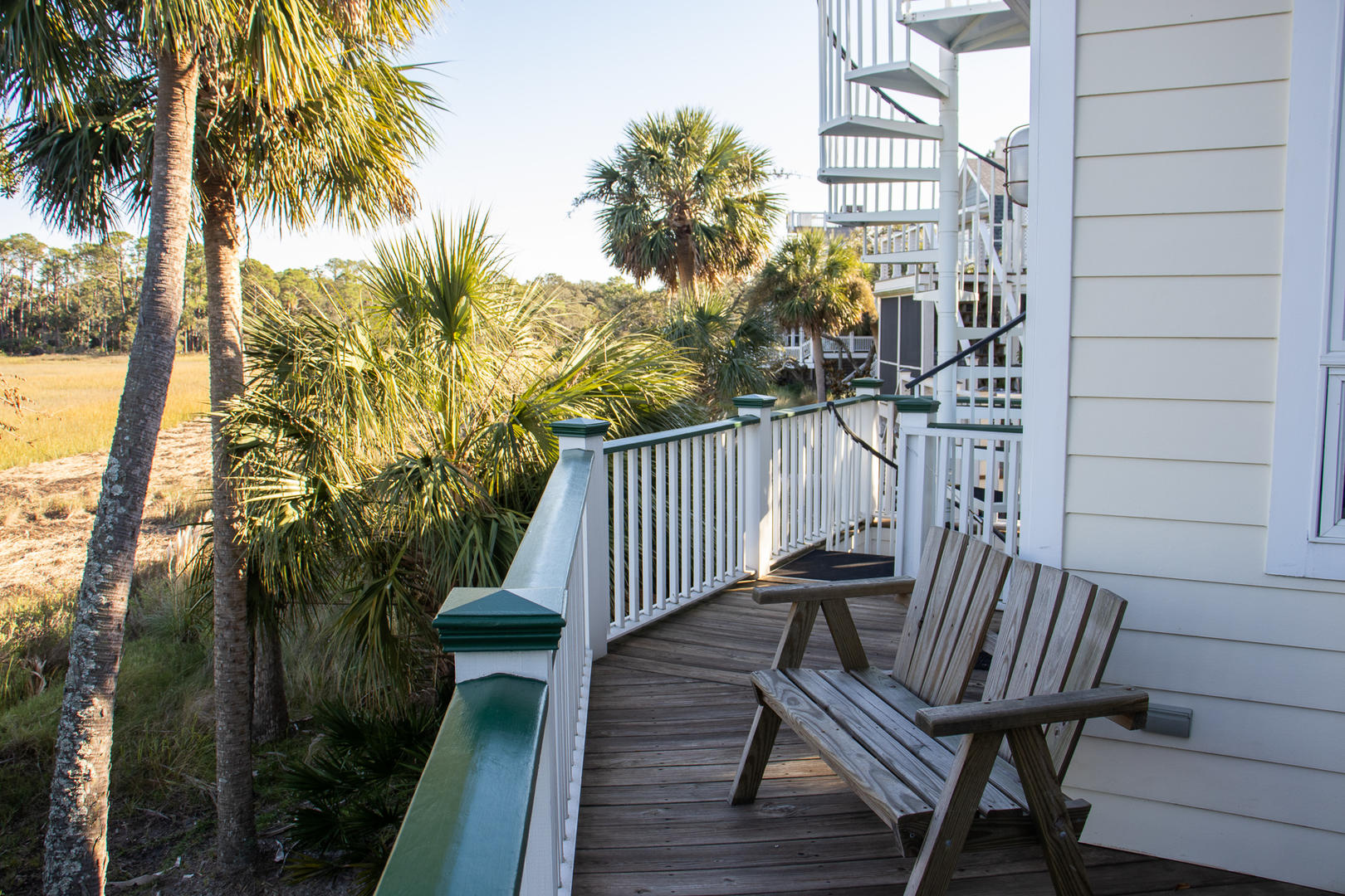 Back deck, grill on ground level, spiral staircase to upstairs deck