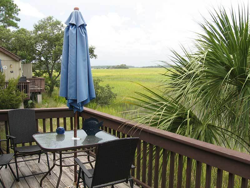 Enjoy dinner outside while gazing at the marsh
