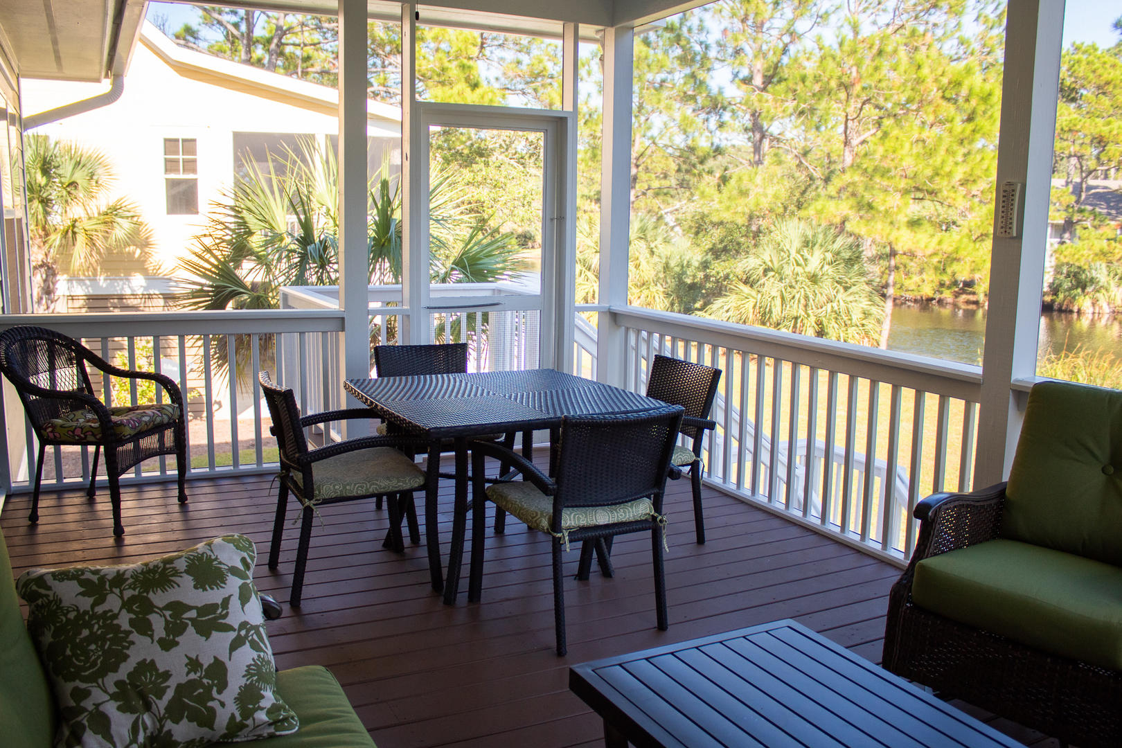Off dining room and kitchen, screened with outdoor table and seating