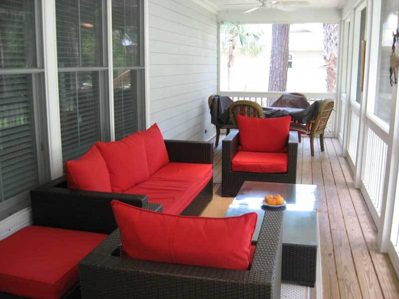 Large back porch with comfortable and cozy furniture to relax on while your enjoy the gorgeous weather..