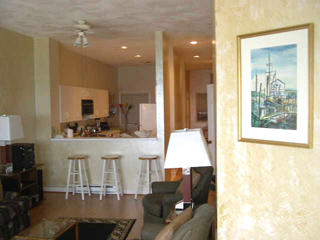 View of the breakfast bar and kitchen from the living room