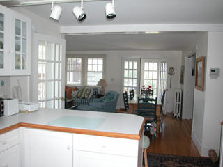 View from kitchen to dining area and porch beyond