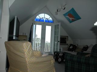 Third floor family room with plasma TV