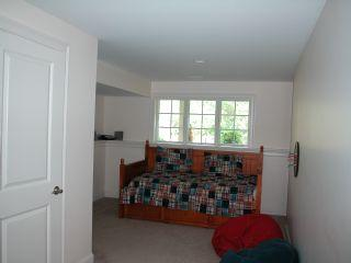 Kids area on the lower level with full bath, TV and two trundle beds