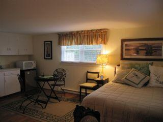 Separate guest room with a queen bed, kitchenette and bath