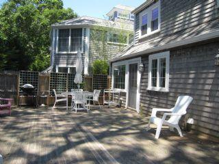 View of the deck, privacy fence and the neighboring condo