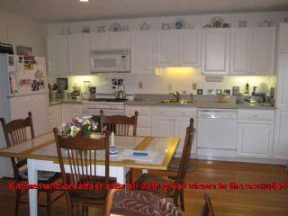Kitchen and breatfast area all with great views to the secluded backyard