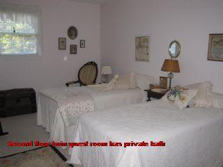 Second floor twin guest room has private bath