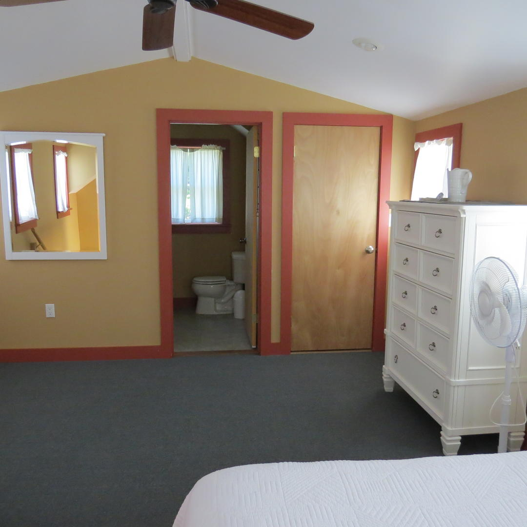 Another view of the guest cottage bedroom with full bath