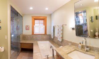 Master bath with walk through shower and tub
