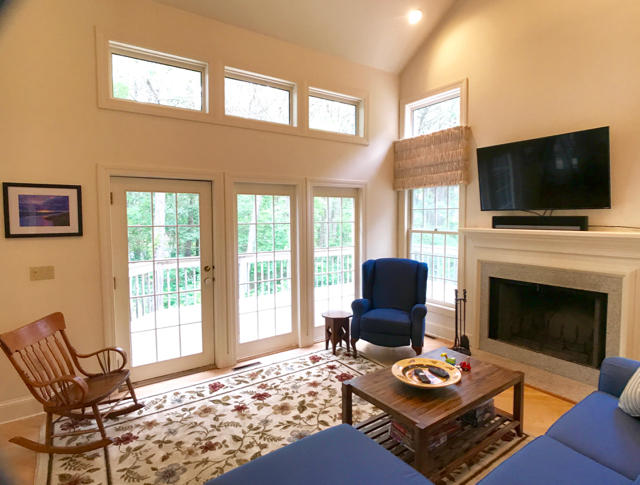 Another view of the  living-room with french doors to the deck