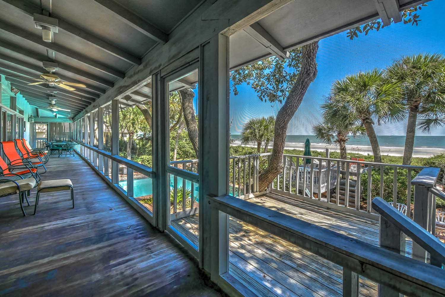 Screened porch off living room | Beach House