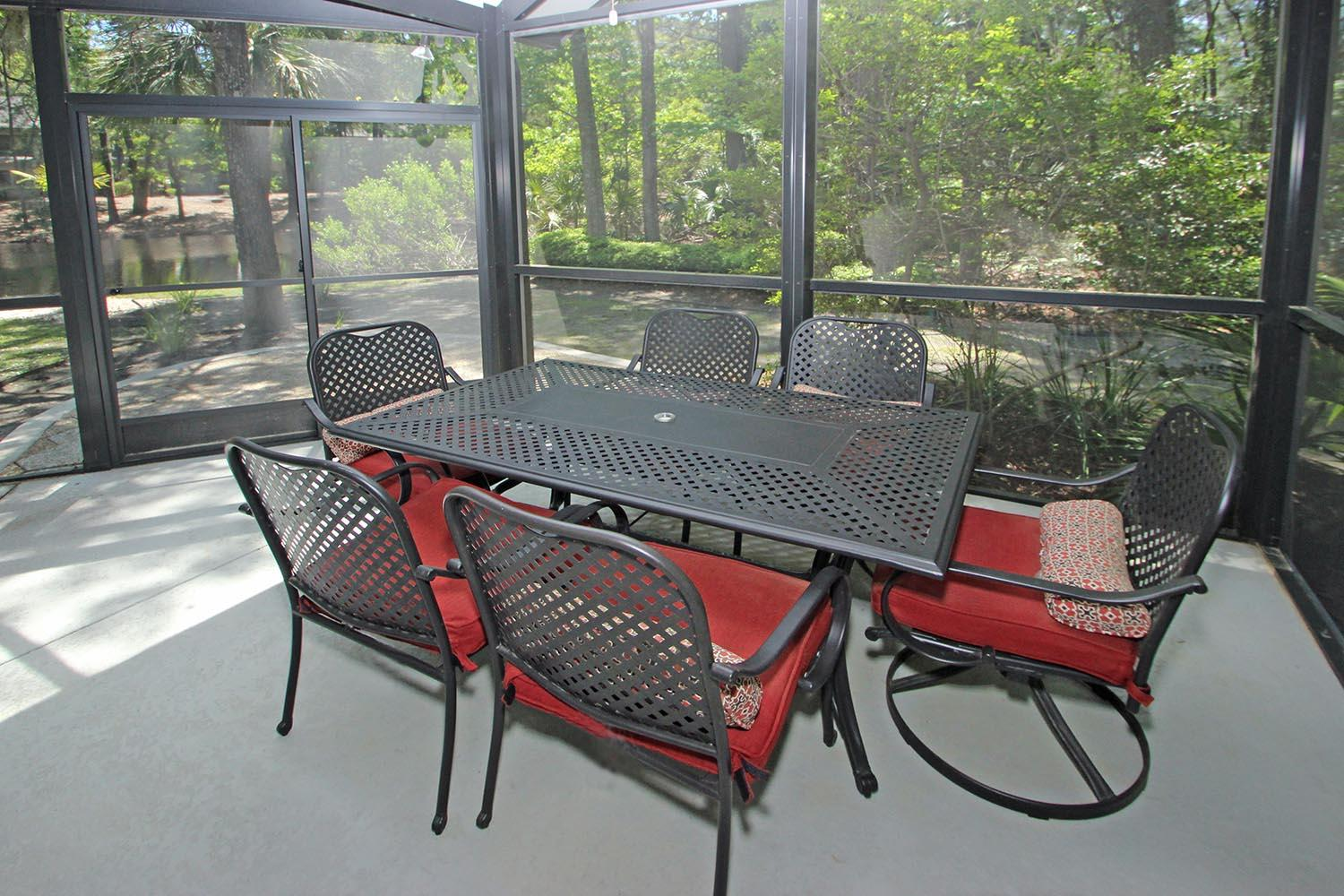 Screened porch with table and chairs