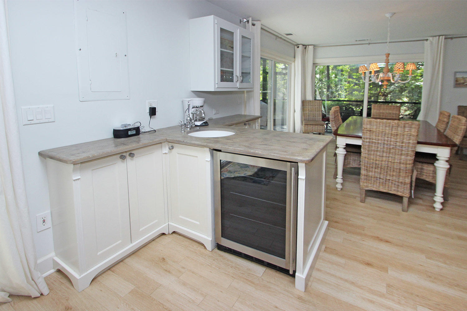 Wet bar by kitchen and dining area