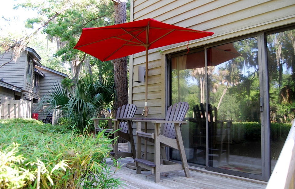 Back deck with table chairs umbrella