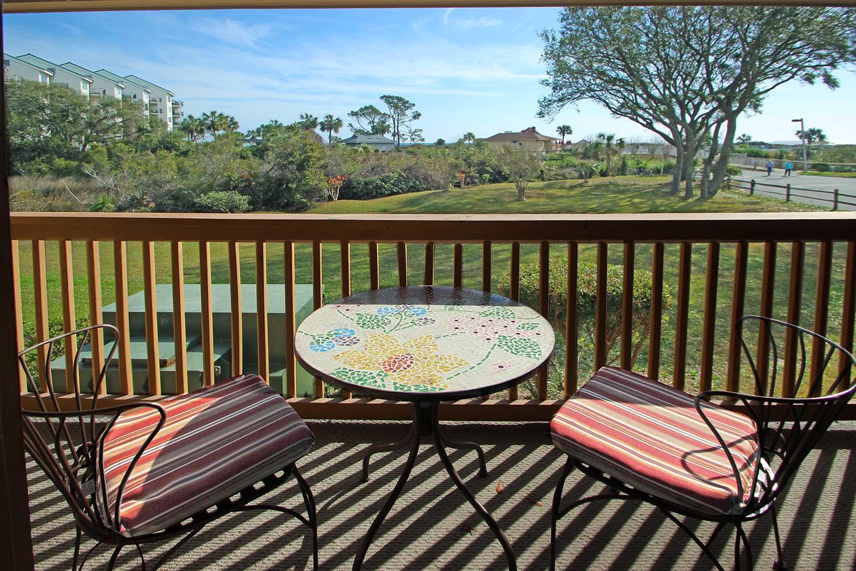 Balcony overlooking grounds and ocean