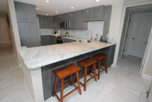 Kitchen and bar top with stools