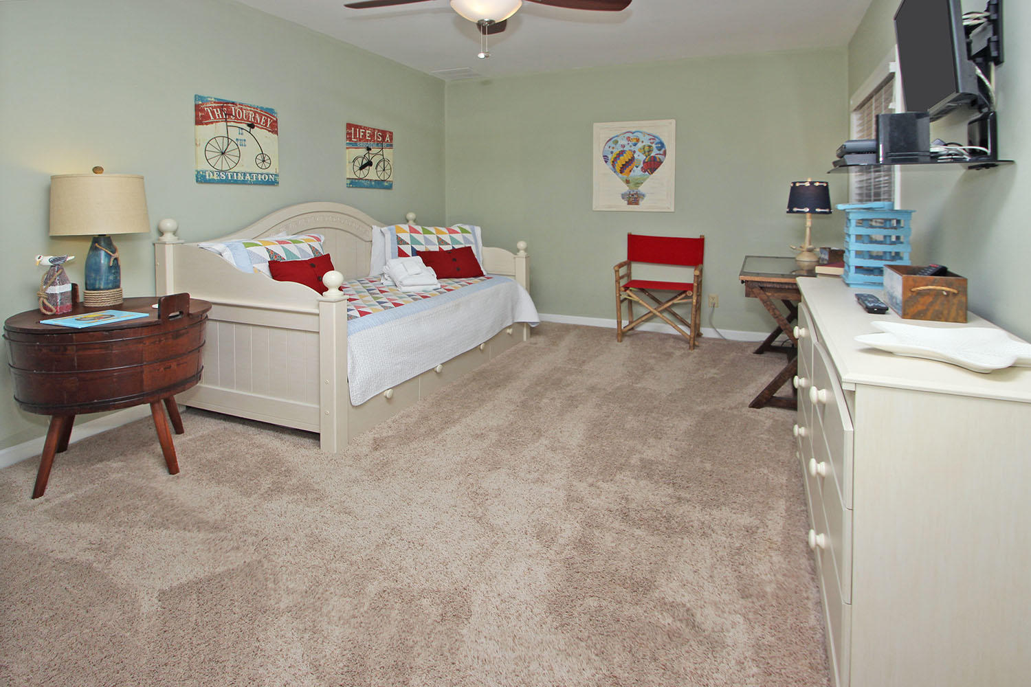 Guest bedroom with day bed and trundle bed