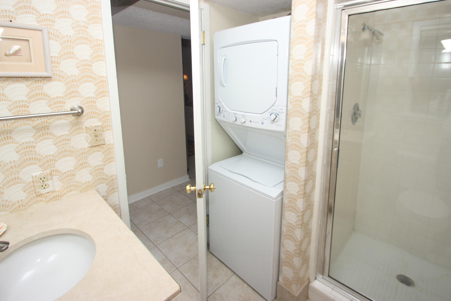 Full bath off foyer with washer-dryer