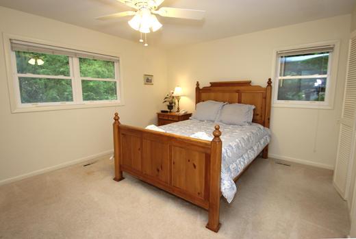 Guest bedroom upstairs with queen