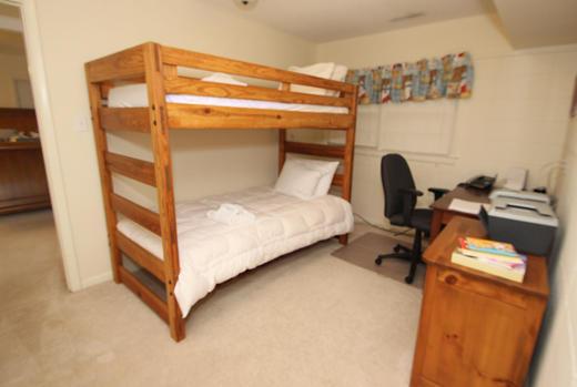 Bunk bedroom with computer desk