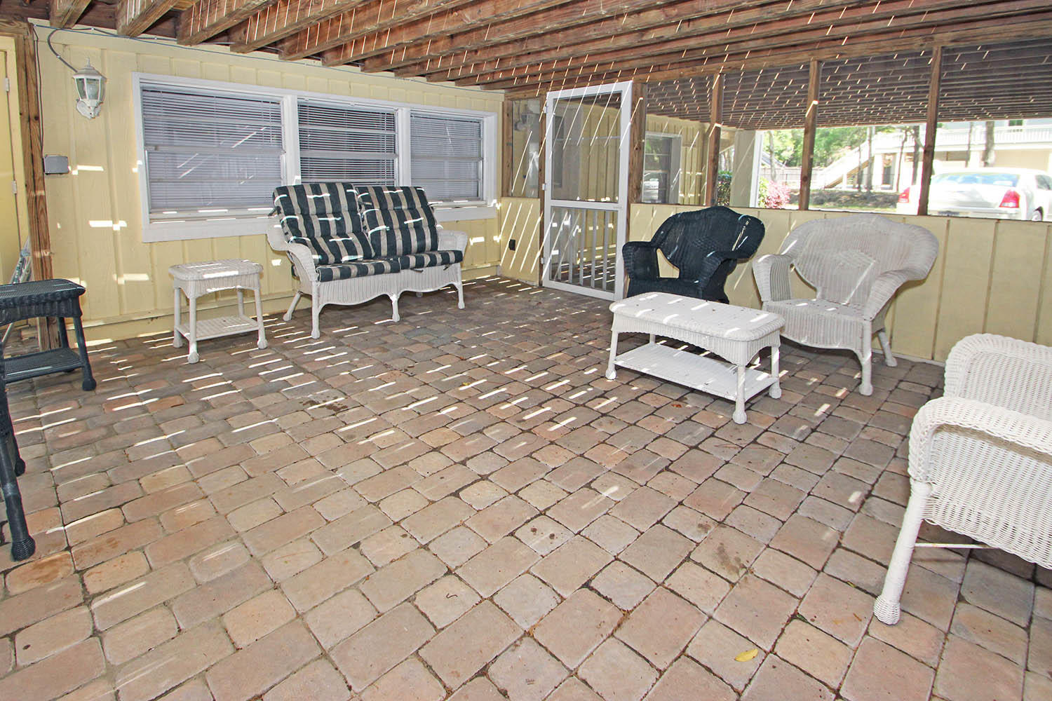 Screened porch by pool area