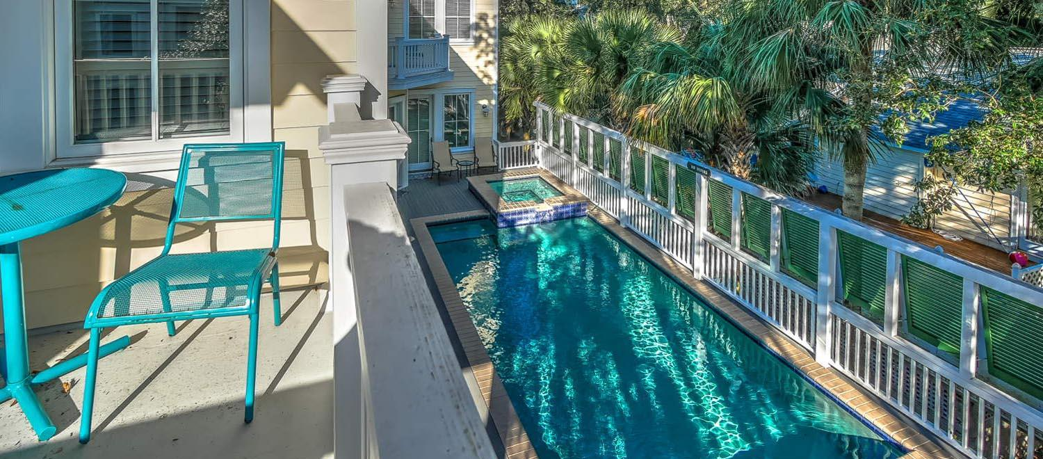 View of pool from balcony | The Sandy Pelican