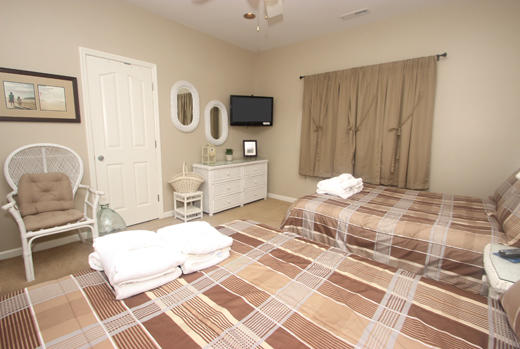 Guest bedroom two with double beds 2