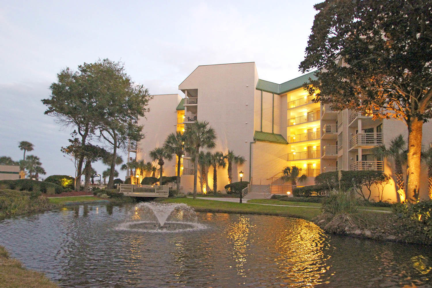 Building by lagoon at dusk
